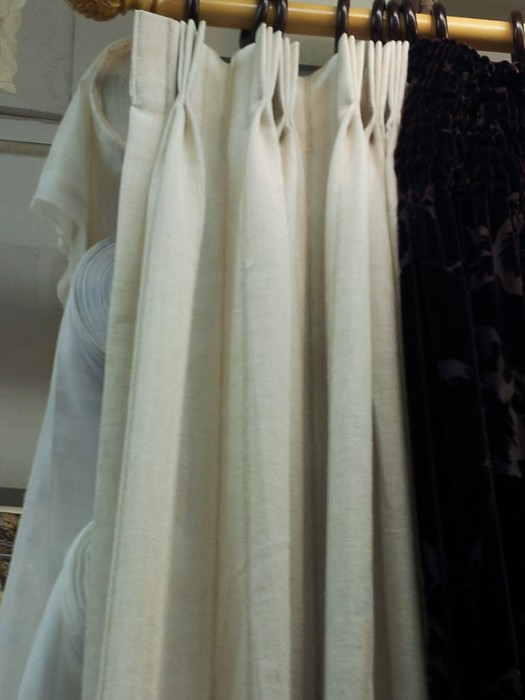 Inverted pleats on both sheer and main fabric.