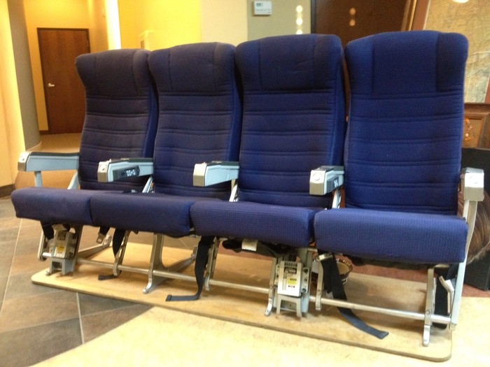 The Chairs Have Seat Belts, Seat Back Tables, And Recline About 15  Degrees...also, Ash Trays (which Means They Must Be Old!)