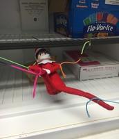 Eddie tied up in the freezer taken hostage.
