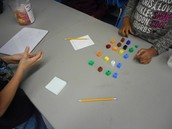 Math Lab students using cubes to solve a problem