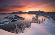 Photo of the sunsetting at Crater Lake