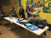 Our amazing Pillow PTA selling shirts, sweaters, & Science of Spin yo-yo's at CATCH Night!