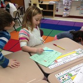Grade 2 student sharing her thinking with a peer.