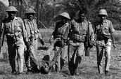 Pakastani soldiers carry away the corpse of an Indian counterpart