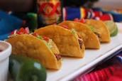 cinco tacos(dos mil ochientos setenta y tres pesos 2.873)