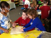 PES - 5th grade students work with kindergarten students to build houses