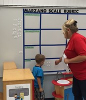 Pre-K Interacting with Scales