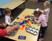 Sorting buttons in Sensory Room.
