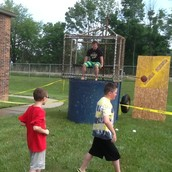 Mr. Young takes a turn in the Dunking Booth. Splash!