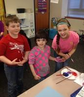 Skylar mentoring in the Kindergarten classroom