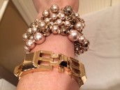 Pearl Bracelet is $30 and the Gold Link Bracelet is $40