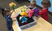 Planting and picking flowers in Sensory Room