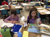 Noa and Lily finding main ideas and details while partner reading