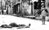 a little girl looking at a corpse on a street somewhere in occupied Bangladesh