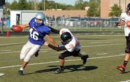 Oak Grove making a tackle