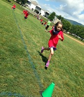 Abigail running to the finish line!