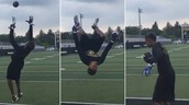To catch a football while doing  back flip.