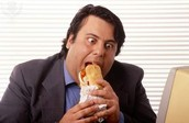 Guy eating sandwhich