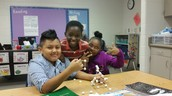 """Ms. Velie's Small Group 2nd grade students creating a Marshmallow Mansion for our """"How To"""" writing piece."""
