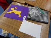 Student created tanagrams as students study plane and geometric figures in Rachel Grochowski's second grade class