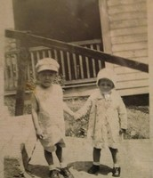 Pappy as a child holding his little sisters hand