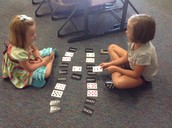 "Addison and Guin playing ""Ten in a Row"""