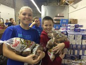 JYIT at Save-A-Lot Boxing Food for Needy