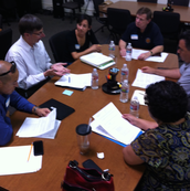 Postsecondary and business representatives review Performance Tasks