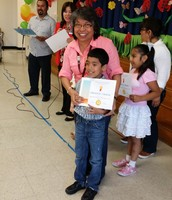 Ms. Saravia and one of the first grader as Student of the Month
