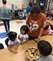 PK3 kids make fresh applesauce