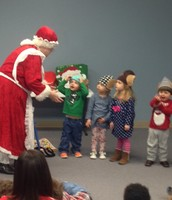 Toddlers and Two Help Mrs. Claus tell a Story