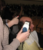 Mr. Dickson getting head shaved to raise $