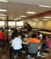 Mr. Bruce Jones meets with DHS students in the cafeteria!  Mr. Jones shares college and job opportunities with students.