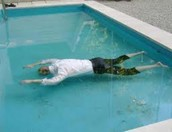 Gatsby found shot in pool.