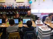 Mr. Davidson Working with Students