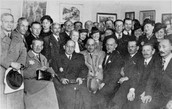 Group portrait of members of the Lodz ghetto administration at a cultural event in the ghetto.