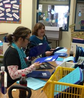 These two wonderful ladies help the entire school stuff information for Thursday folders each week.