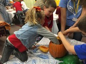 Miss Bailey and Mr. Jesse digging in the pumpkin!!