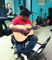 Titus Playing Guitar In The New Studio