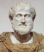 A stone figure of Aristotle.