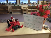 Maria decorated the room for Mrs. Rickman's birthday.  She was decorated as well and riding a lego car, ready to go back to the North Pole.
