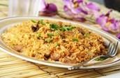 El pollo y arroz