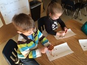 Our future paleontologist, practicing with chocolate chip cookies !