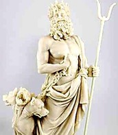 sculpture of Hades with his scepter and the cerebus