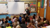 Mr. Freeman reads to Mrs. Stuckenschnieder, Mrs. Power, Ms. Rodgers and Ms. Lodderhose's classes today.