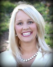 Kelly Heckert--Senior Executive Director