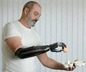 man picking up a egg with cyborg arm**************