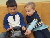 1st grader and Pre-K student try their hand at coding.