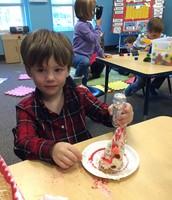 Preston-adding sprinkles to his edible Christmas Tree
