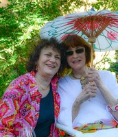 Anita and Gloria Vanderbilt under the parasol. As always the weekend concludes with a glorious garden party at the Callaghan's Rosedale home.